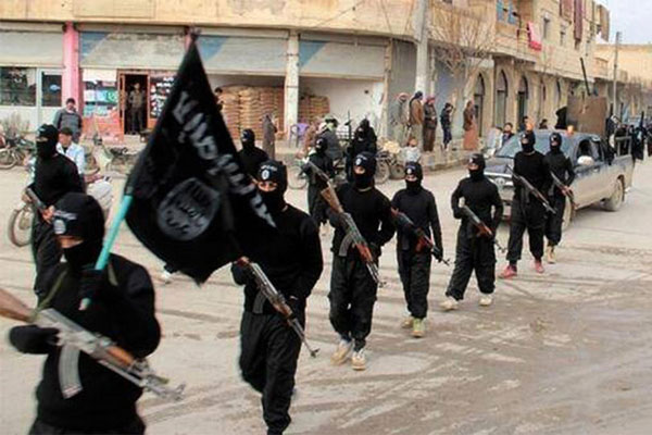 In this undated file image posted on a militant website on Tuesday, Jan. 14, 2014, fighters from the al-Qaida linked Islamic State group, march in Raqqa, Syria. (AP Photo/File)