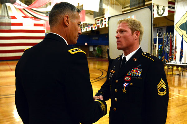 Sgt. 1st Class Richard Harris (right) shakes hands with Lt. Gen. Ken Tovo, commander of U.S. Army Special Operations Command, after receiving the Silver Star Medal on June 3 at Fort Carson, Colo. (US Army photo/Jeffrey Smith)