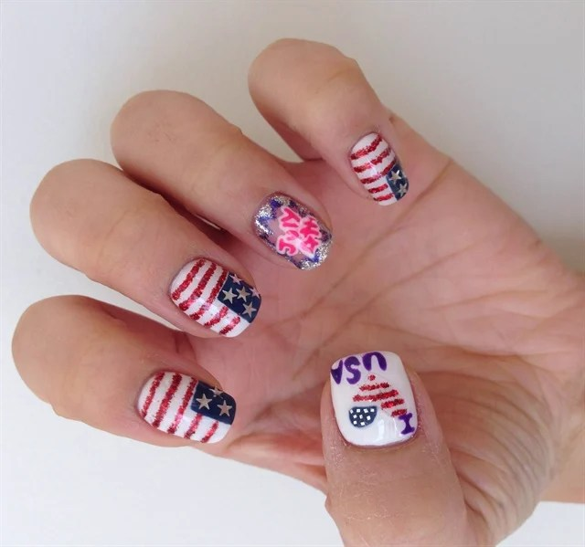 5 Paint A Heart Shape On The Thumb Using Thin Paintbrush Red Glitter Stripes And Small Blue Patch White Nail Polish Anda Needle