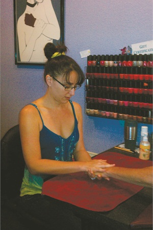 Beauty Pro At Work In Nail Salon
