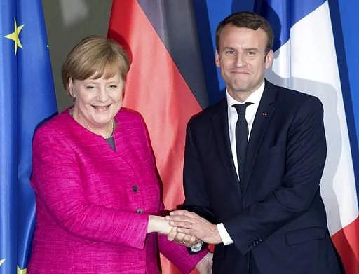 Image result for photo of macron in germany