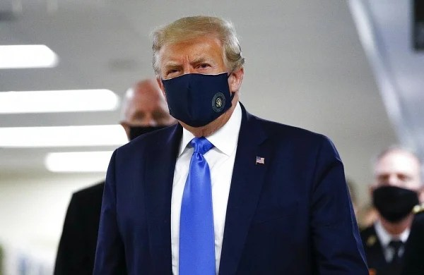 Trump wears mask in public for first time during COVID-19as US cases surge past 3.2 million