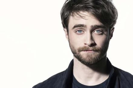 Daniel Radcliffe staring into camera with a beard