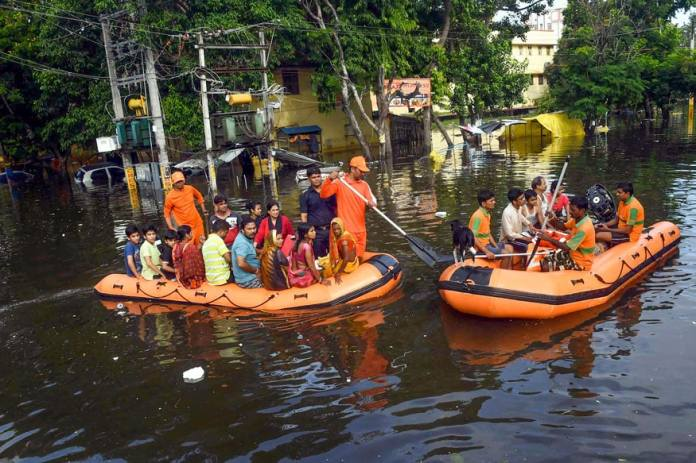 National and State Disaster Response Force personnel rescue people