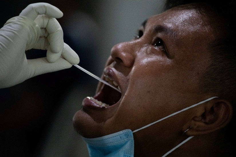 A vendor at Pritil Public Market gets a free swab test amid the coronavirus disease (COVID-19) outbreak, in Tondo, Manila, Philippines, October 8, 2020. REUTERS/Eloisa Lopez