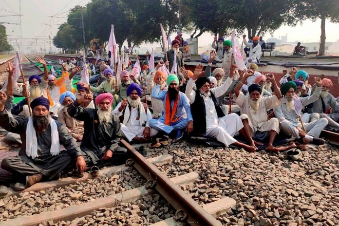 Farmers block a railway track during a protest against the new farm law, at Jandiala Guru in Amritsar, Wednesday, November 4, 2020. (Image: PTI)