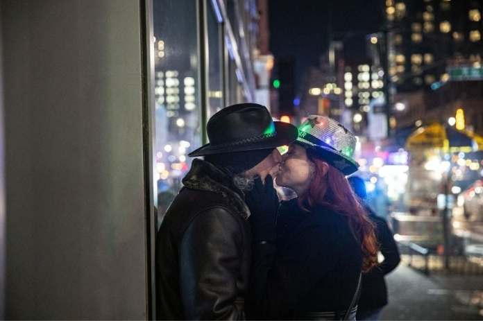 Representative image: A couple kisses near Times Square during the virtual New Year's Eve event following the outbreak of the coronavirus disease (COVID-19) in the Manhattan borough of New York City, New York, U.S., December 31, 2020. REUTERS/Jeenah Moon