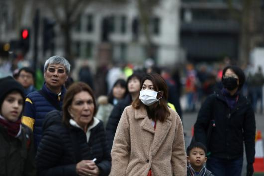 People wearing face masks are pictured in London, Britain.
