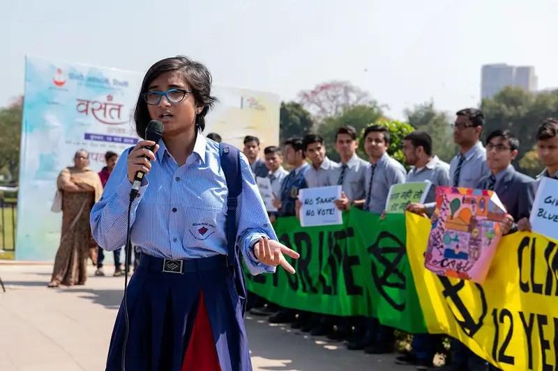 An Indian student speaks in a school strike in New Delhi