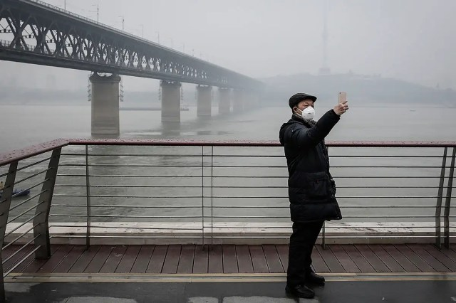 A man wears a mask near Wuhan, China