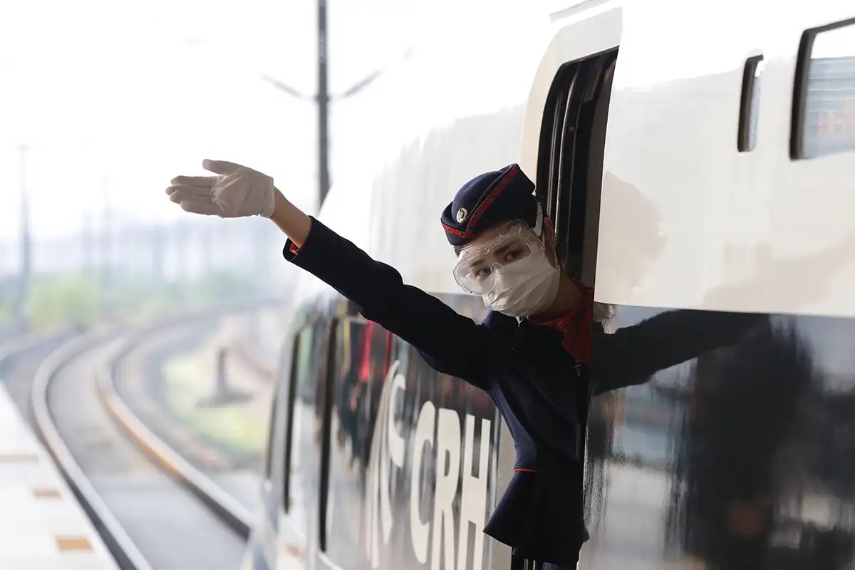 woman attendant on train leaving wuhan after coronavirus lockdown ends
