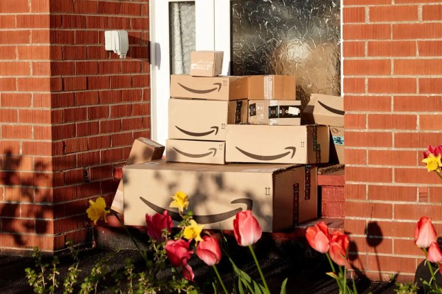 large consignment of amazon deliveries left on doorstep of house during coronavirus covid-19 lockdown in the uk