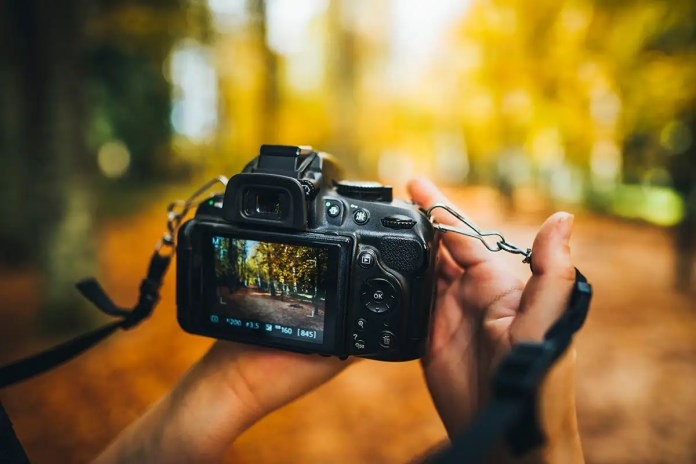Two hands holding a camera