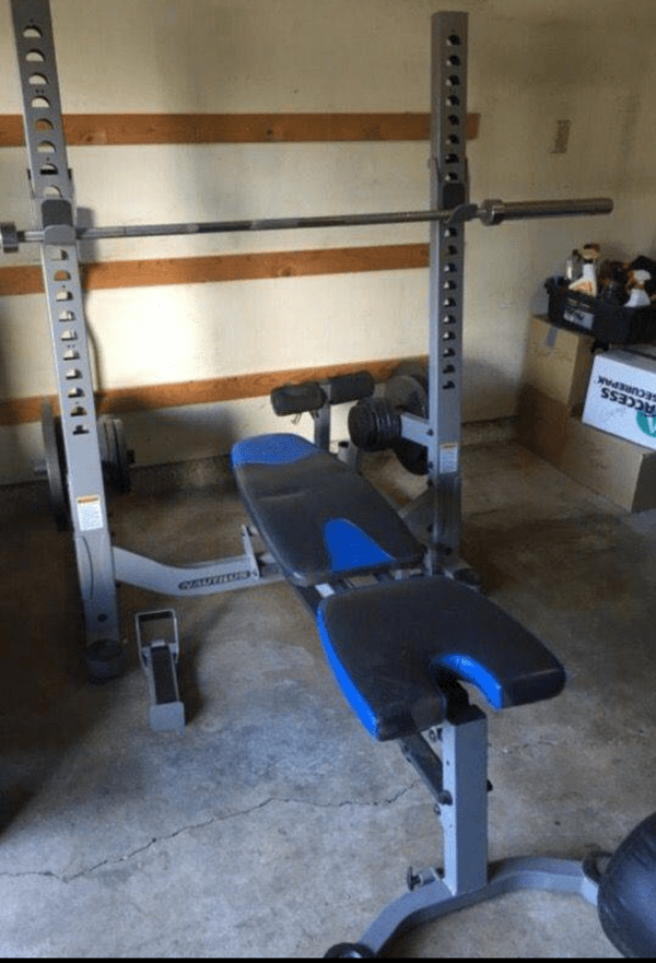 Nautilus Folding Bench Press Squat Rack Olympic Bars And