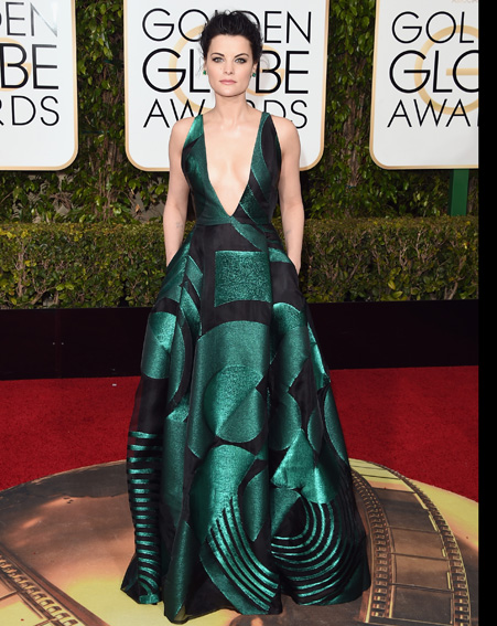 Jamie Alexander stand out in a low cut emerald gown [Getty]