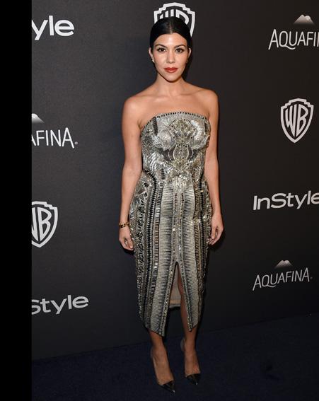 Kourtney Kardashian stuns in a metallic silver dress [Getty]