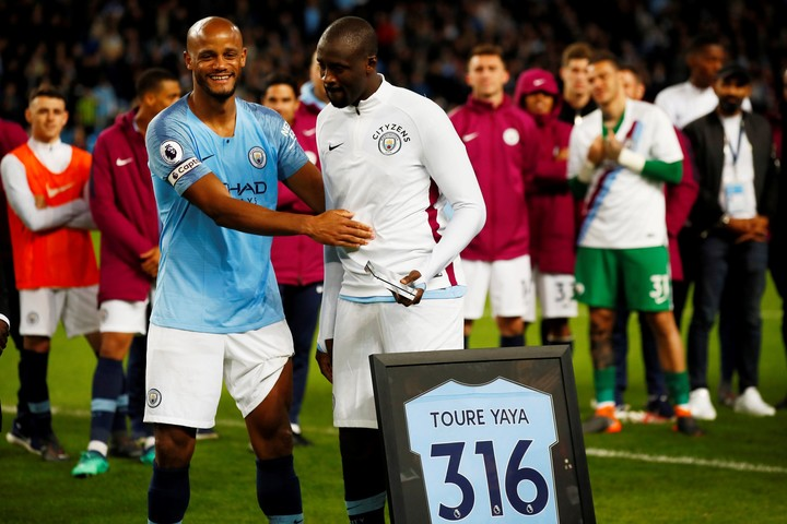 Kompany with Yaya Toure.  Two of the most beloved players in the club.  (Reuters)