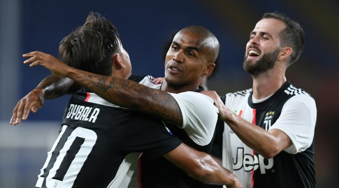 Dybala and Pjanic celebrate with Douglas Costa (Reuters)