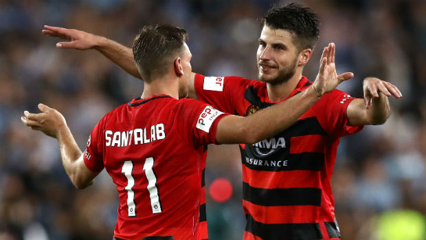 Brendon Santalab and Terry Antonis embrace following the Wanderers win in Saturday night's Sydney Derby.