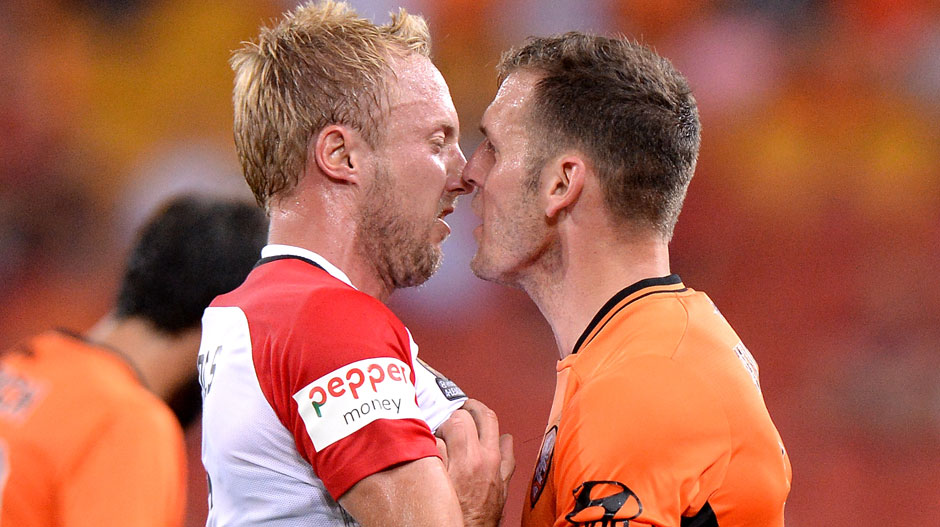 Wanderers midfielder Mitch Nichols and Roar defender Luke DeVere were looking to spread the Christmas love in their Rd 12 clash in Brisbane.