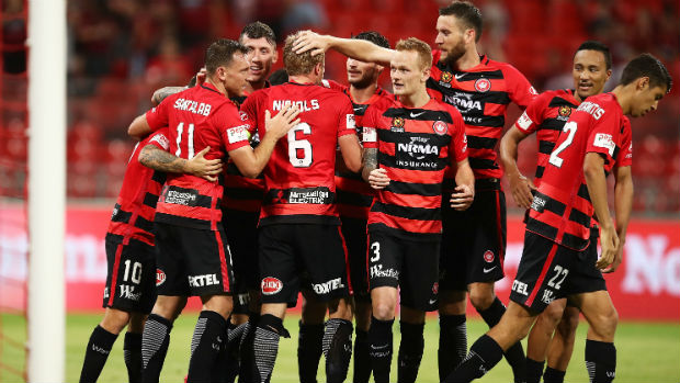 The Wanderers celebrate one of Brendon Santalab's two goals against the Phoenix on Sunday.