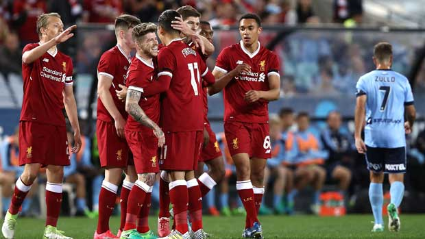 Liverpool players celebrate one of their three first half goals in the win over Sydney FC.