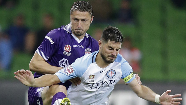 Glory defender Dino Djulbic fights for the ball with City captain Bruno Fornaroli.