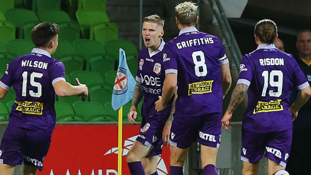 Perth Glory players celebrate one of Andy Keogh's goals against City on Friday night.