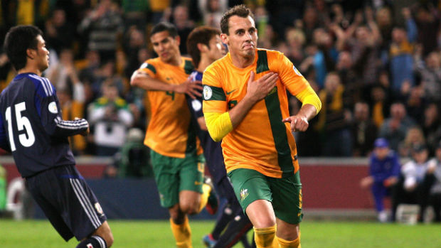Luke Wilkshire celebrates scoring for the Socceroos against Japan at Brisbane Stadium in 2012.