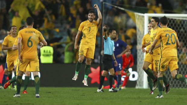 The Caltex Socceroos celebrate Mat Leckie's late winner against Greece at ANZ Stadium in June.