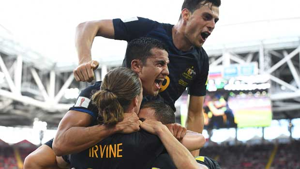 Tim Cahill celebrates with teammates after James Troisi opened the scoring against Chile in Moscow.
