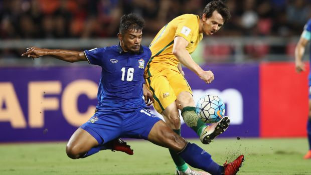 Robbie Kruse is tackled by Thailand's Prathum Chuthong in Tuesday night's WCQ.