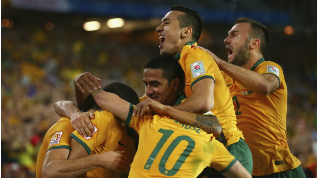 The Socceroos celebrate Massimo's Luongo's opening goal in the Asian Cup final.