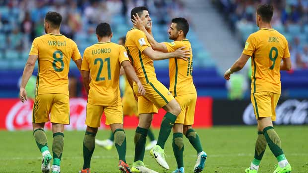 The Caltex Socceroos celebrate Tom Rogic's goal in the first half against Germany.