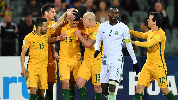 The Caltex Socceroos players celebrate Tom Rogic's second half strike against Saudi Arabia.