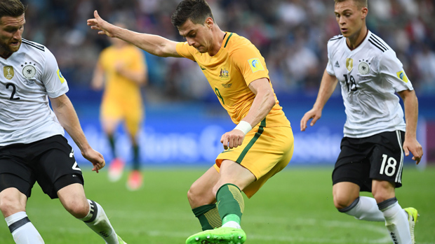 Tomi Juric on the ball during Australia's 3-2 loss to Germany.