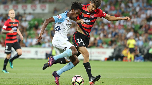 Wanderers defender Jonathan Aspropotamitis tackles City forward Bruce Kamau when their sides met in Round 14 of the Hyundai A-League.