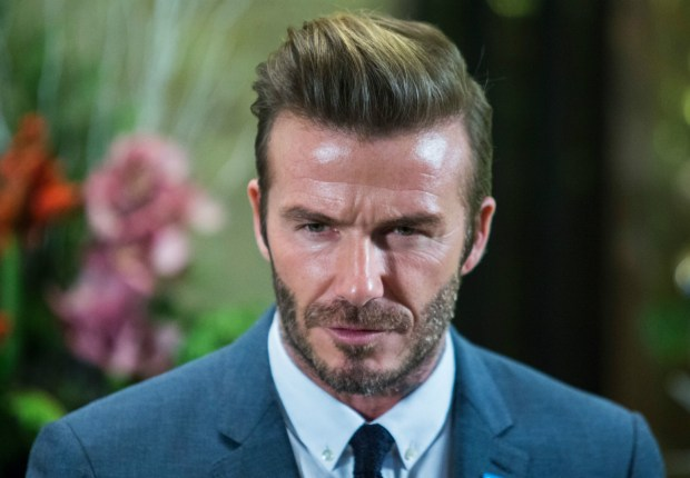 Beckham defends kissing daughter on the lips