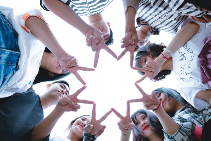 Group of People Forming Star Using Their Hands