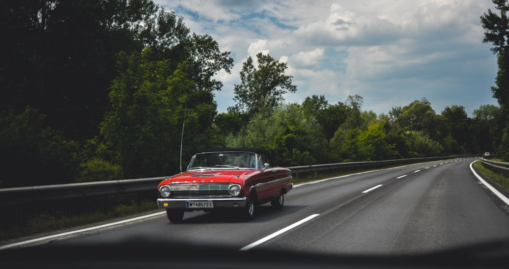 Photography of Red Car on Road