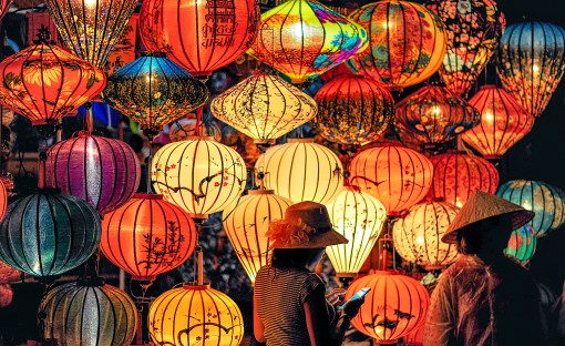 Two Person Standing Near Assorted-color Paper Lanterns