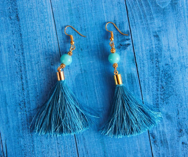 Close-Up Photography of Blue Earrings