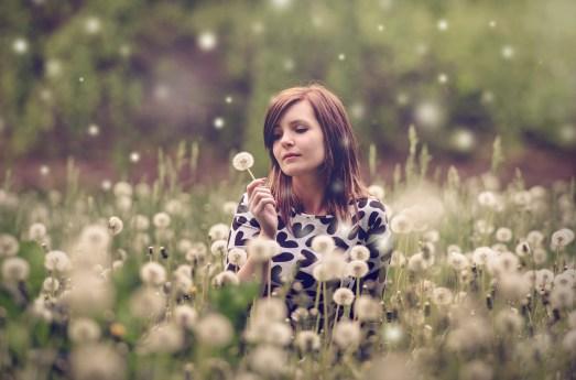 Woman Sitting in a Field of Flowers