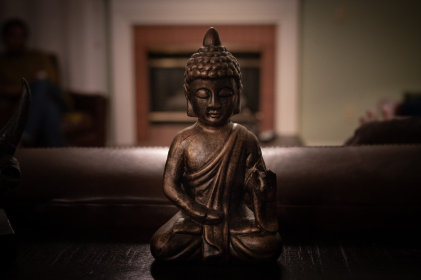 Brass Buddha Figurine on Black Surface