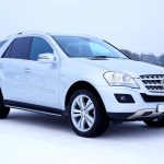 White Mercedes Benz Suv Parked Beside Brown Wooden Fence Free Stock Photo