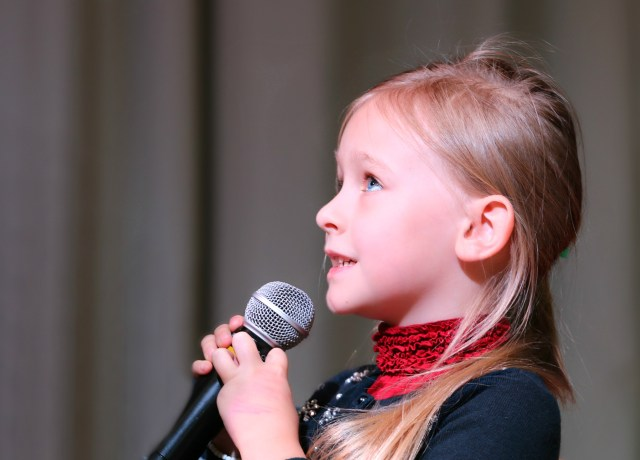Girl Holding Black Dynamic Microphone While Looking Above glossophobia