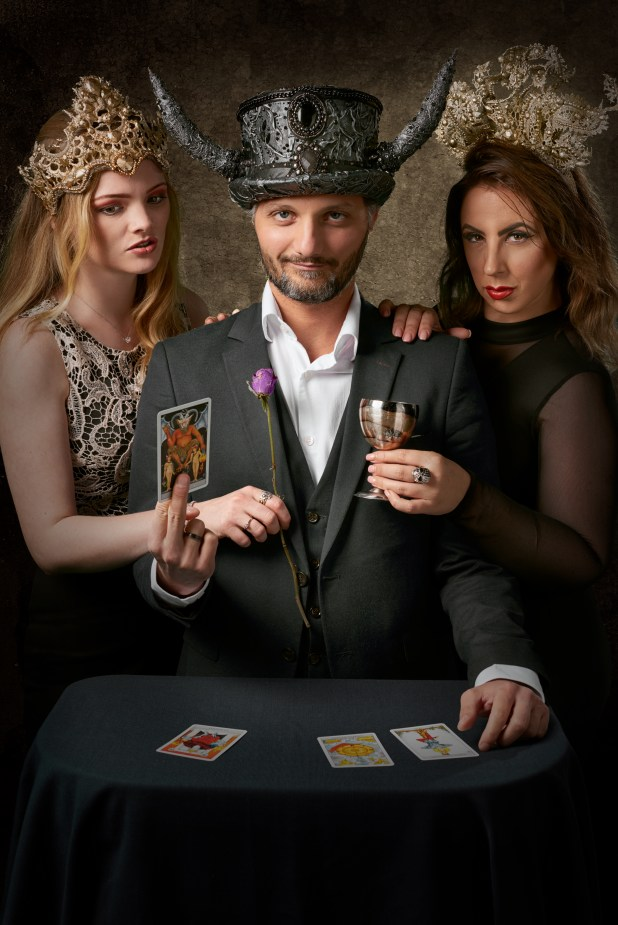 Man Wearing Gray Suit Jacket Holding Tarot Card