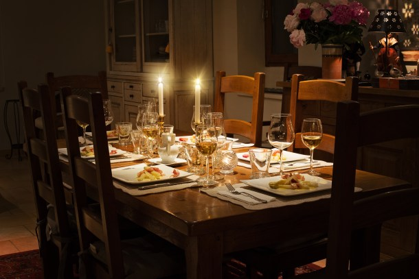 dining room table with dinner set up and candelights