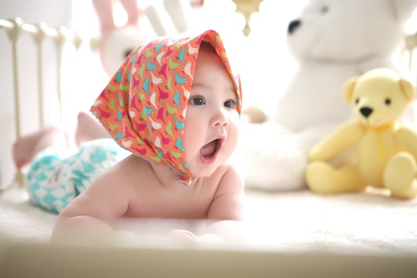 Toddler Wearing Head Scarf in Bed