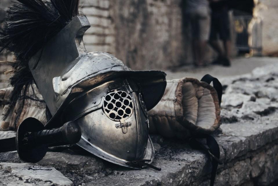 Silver Spartan Helmet Beside Sword